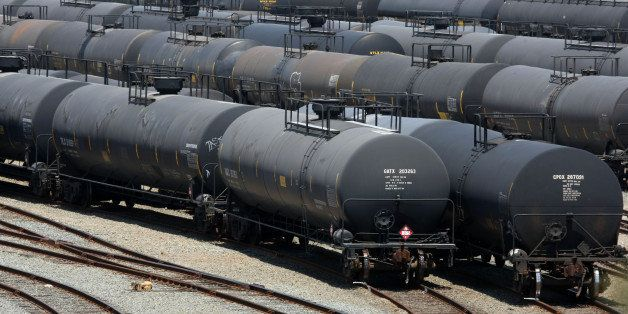RICHMOND, CA - JULY 14: Railroad tanker cars sit outside of the Chevron refinery July 14, 2008 in Richmond, California. As gasoline prices continue to climb to a national average of $4.11 per gallon of regular unleaded, U.S. President George Bush announced today that he has lifted the executive ban on offshore oil drilling that his father, former U.S. President George H.W. Bush imposed during his term in office. (Photo by Justin Sullivan/Getty Images)