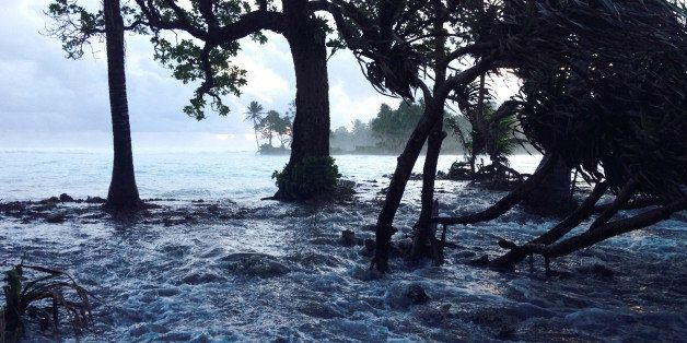 A high tide energized by storm surges washes across Ejit Island in Majuro Atoll, Marshall Islands on March 3, 2014, causing w