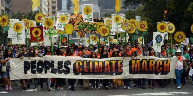 Marchers make their way across Central Park South during the People's Climate March on September 21 2014, in New York. Activi