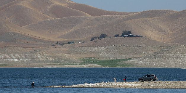 GUSTINE, CA - SEPTEMBER 05: A car is parked on a section of the San Luis Reservoir that used to be under water on September 5