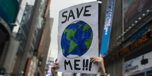 A demonstrator holds up a sign during the People's Climate March in New York, U.S., on Sunday, Sept. 21, 2014. The United Nat