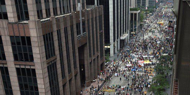 Marchers come down 6th Ave during the People's Climate March on September 21 2014, in New York. Activists mobilized in cities