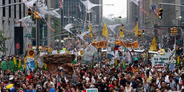 Demonstrators make their way down Sixth Avenue in New York during the People's Climate March Sunday, Sept. 21, 2014.  The mar
