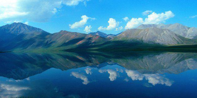 Alaska, Arctic National Wildlife Refuge, ANWR, Reflections of Brooks Range Mountains in Schrader Lake. (Photo by: Universal I