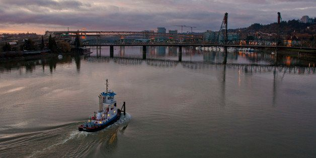 PORTLAND, OR - FEBRUARY 11:  A tugboat makes its way up the Willamette River in the early morning on February 11, 2012, in Po