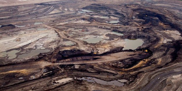 The Syncrude Canada Ltd. base plant stands in this aerial photograph taken above the Athabasca Oil Sands near Fort McMurray,