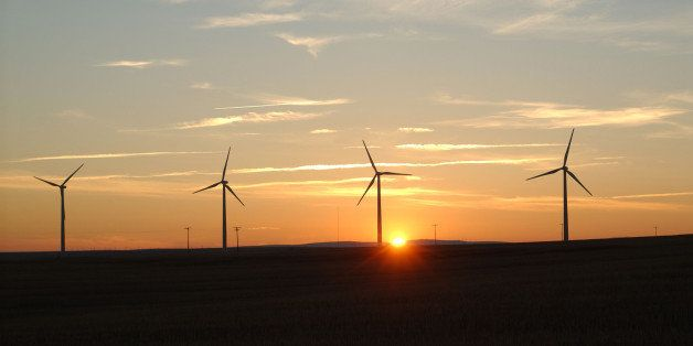 WASCO, OR - NOVEMBER 16:  The sun sets beyond turbines in the recently completed Klondike II wind farm, expected to produce e