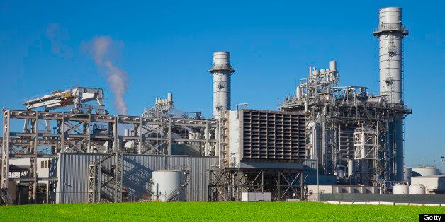 Natural gas fired turbine power plant with it's cooling towers rising into a blue sky