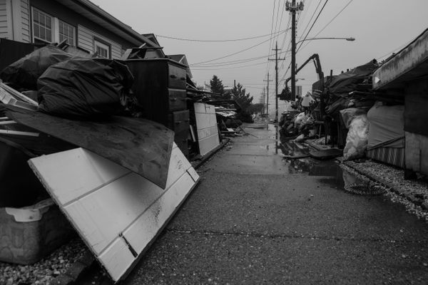 12/10/12: Long Beach Island, NJ: Sidewalk Surrounded by Debris.