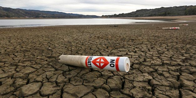 FILE -- In this Feb. 4, 2014 file photo, a warning buoy sits on the dry, cracked bed of Lake Mendocino near Ukiah, Calif.  Th