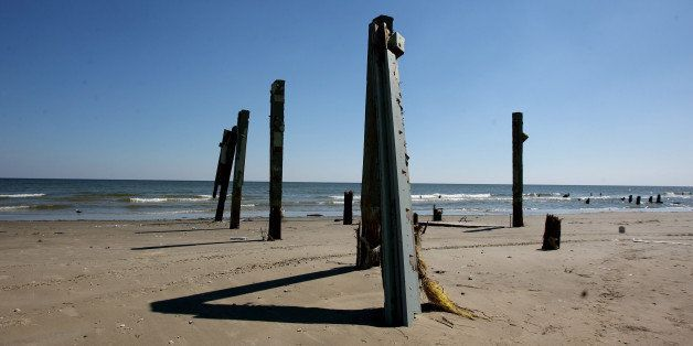 Support poles are all that is left of homes destroyed by Hurricane Ike line the west end of Jamaica Beach on Galveston Island