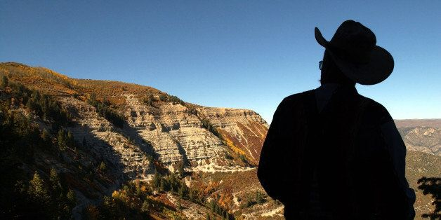 RIFLE, CO, SEPTEMBER 24, 2003 - Bob  Elderkin , 64, of Silt, Colo., gazes out at Roan Plateau, northwest of Rifle, Colo., on