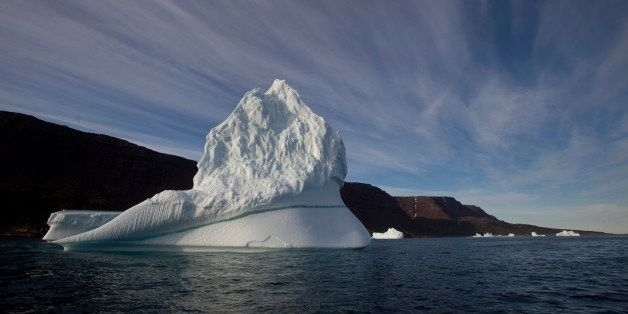 FILE - In this July 21, 2011 file  photo, an iceberg floats in the sea near Qeqertarsuaq, Disko Island, Greenland.  Norway is