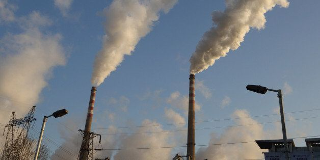 Steam rises from chimneys at the Junliangcheng power station in Tianjin, China, on Wednesday, March 13, 2013. China's money-m