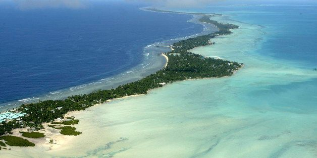 FILE - In this March 30, 2004 file photo, Tarawa atoll, Kiribati, is seen in an aerial view. Fearing that climate change coul