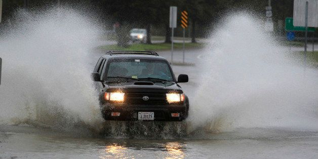 A car plows through a flooded street in the Ocean View area  in Norfolk, VA., Sunday, Oct. 28, 2012.  Rain and wind from Hurr