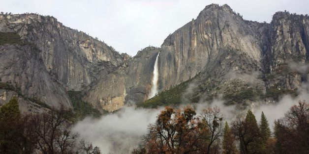 In this photo provided by the National Park Service, Upper Yosemite Falls flows at full force after two days of significant r