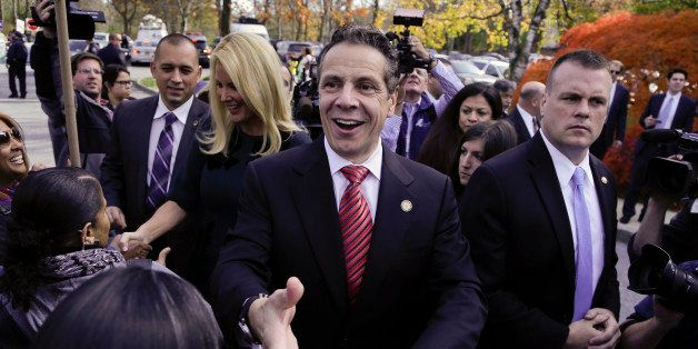 New York Gov. Andrew Cuomo greets supporters and anti-fracking demonstrators after casting his ballot, Tuesday, Nov. 4, 2014, in Mount Kisco, N.Y. A victory by Cuomo over Republican challenger Rob Astorino on Tuesday would make him the first Democratic governor since his father, Mario Cuomo, to win re-election in the nation's third-largest state. (AP Photo/Julie Jacobson)