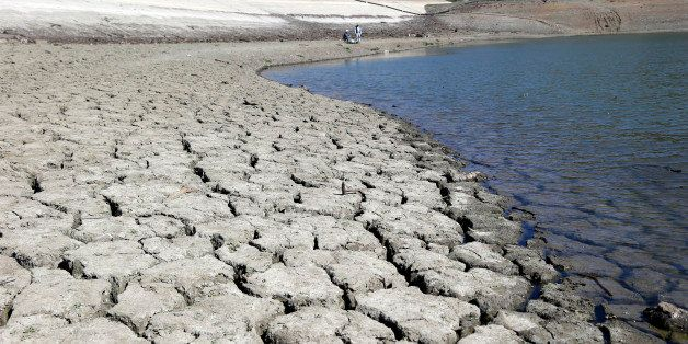The dry-cracked bed of the Stevens Creek Reservoir is seen on Thursday, March 13, 2014, in Cupertino, Calif. Lack of seasonal