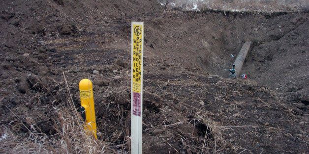 A warning sign shows the location of a 12-inch oil pipeline owned by Bridger Pipeline Co. that spilled up to 50,000 gallons o