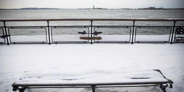 NEW YORK, NY - JANUARY 27:  A park bench is covered in snow after a snowstorm on January 27, 2015 in New York City. The storm