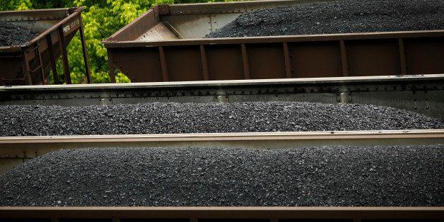 PRINTER, KY - JUNE 3:  CSX Transportation coal trains sit in a rail yard on June 3, 2014 in Printer, Kentucky. New regulation