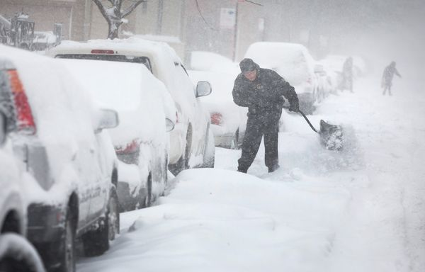 A man digs out his car along a snow-covered street on February 1, 2015 in Chicago, Illinois. (Photo by Scott Olson/Getty Imag