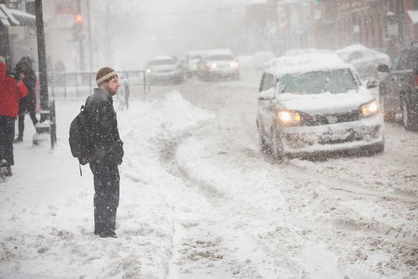 A man waits for a ride along a snow-covered street on February 1, 2015 in Chicago, Illinois. (Photo by Scott Olson/Getty Imag