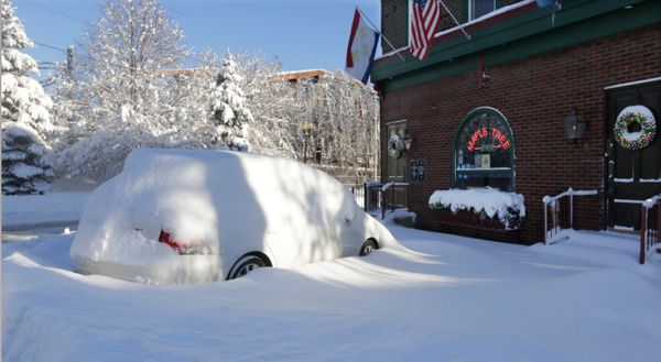 A car parked on Old Western in the entertainment district of Blue Island, Ill., appears abandoned Monday, Feb. 2, 2015, after