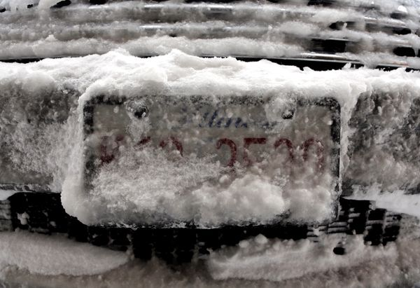 Snow and ice cover a license plate on Sunday, Feb. 1, 2015, in Chicago. (AP Photo/Nam Y. Huh)