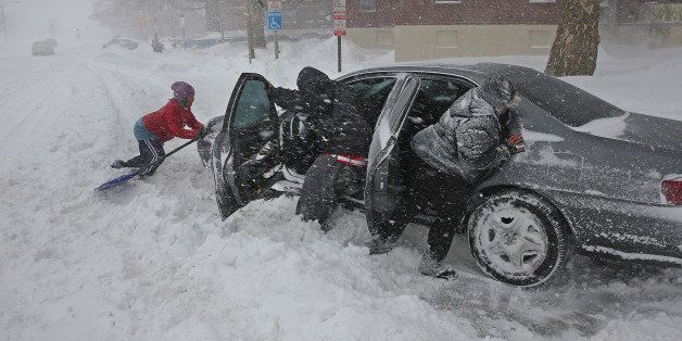 BOSTON - FEBRUARY 2: Left to right, Shirley Jean helps with Mike Jackson's car along with his wife Cay Jackson all try to mov