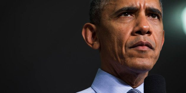 President Barack Obama listens to a question during an event at Ivy Tech Community College, Friday, Feb. 6, 2015, in Indianap