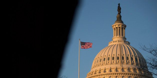 A U.S. flag flies on top of the Capitol building at sunset in Washington, D.C., U.S., on Thursday, Dec. 12, 2013. A U.S. budg