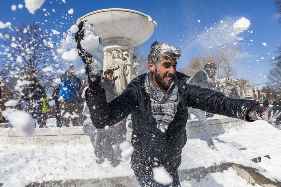Hundreds of people gather for a massive snowball fight at Dupont Circle in Washington, D.C. on February 17, 2015. Washington