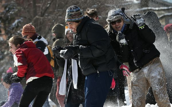 Participants take part in a snowball fight with over one hundred people in Dupont Circle February 17, 2015 in Washington, DC.