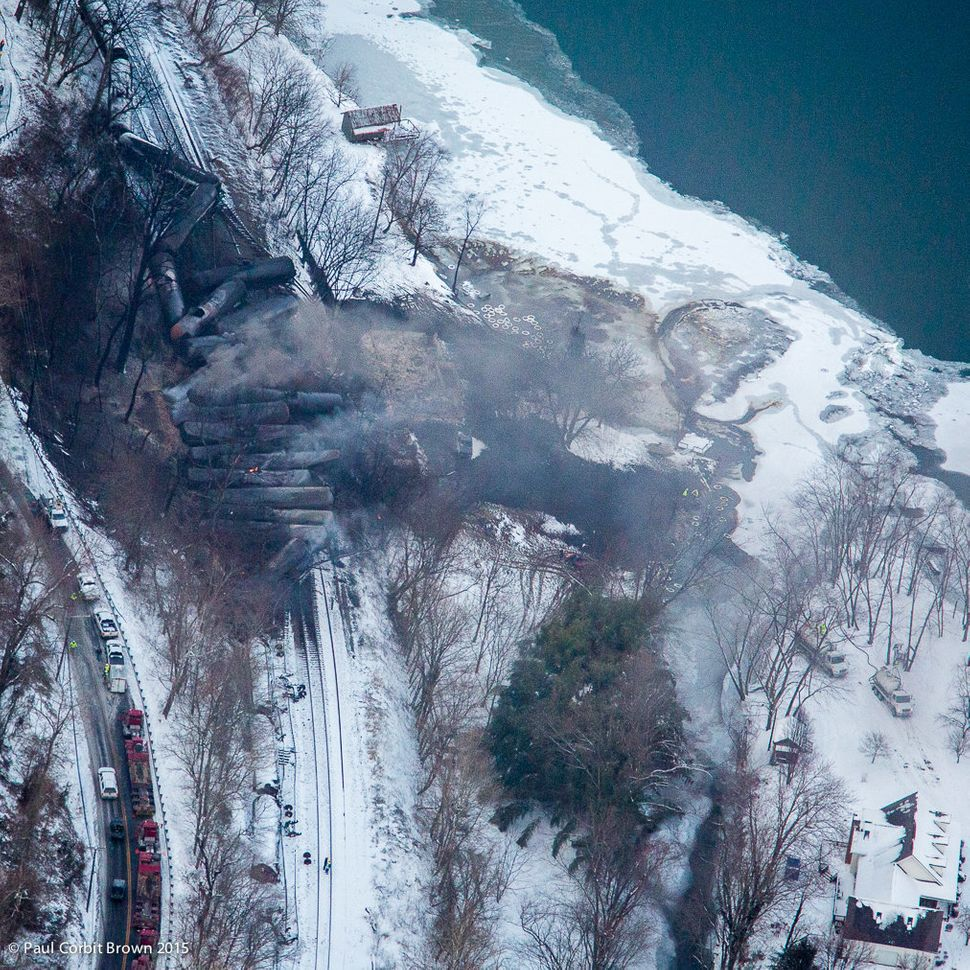 These aerial photos taken by Paul Corbit Brown show the site of the crash of a train that was carrying crude oil through Powe