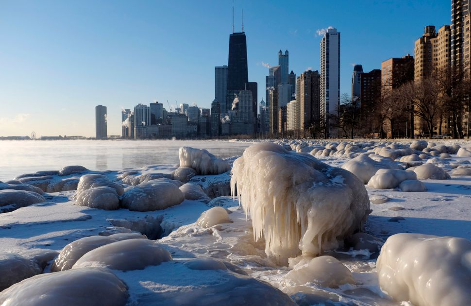 Ice forms along the shore of Lake Michigan, Thursday, Feb. 19, 2015, in Chicago. Temperatures have dipped to as low as -13 in
