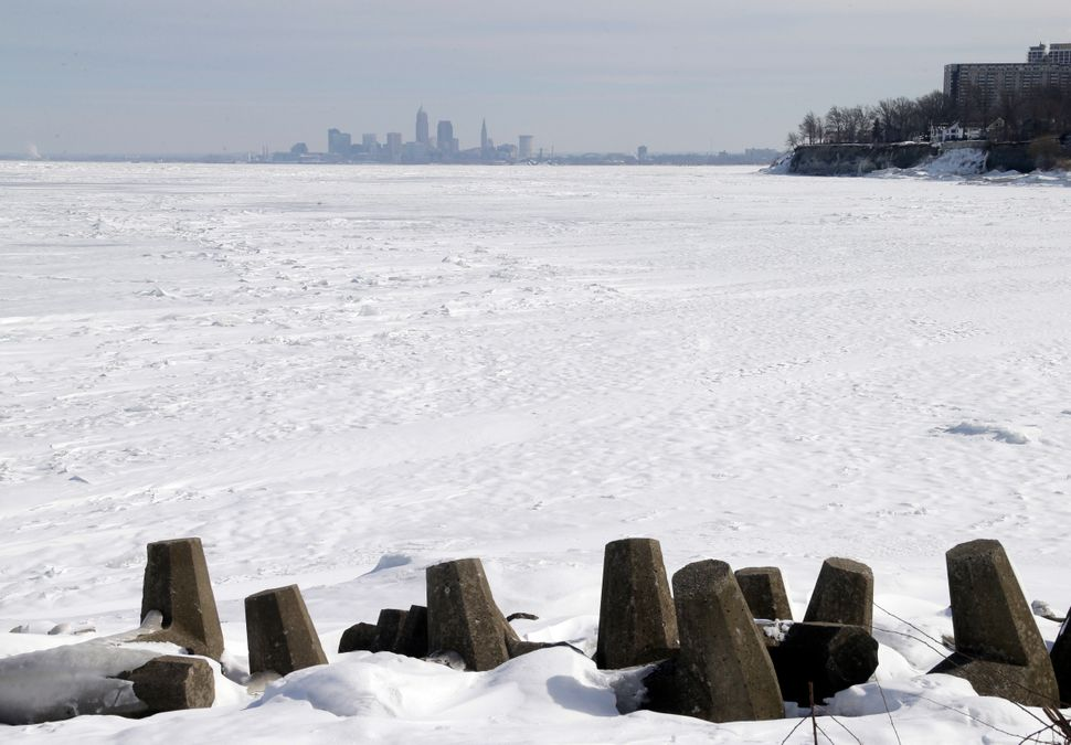 Downtown Cleveland appears to rise from ice-covered Lake Erie in a view from Lakewood Park, in Lakewood, Ohio, Tuesday, Feb.