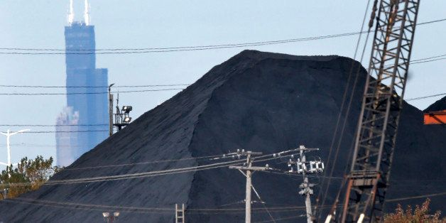 FILE - In this Oct. 25, 2013 file photo, the Willis Tower in downtown Chicago provides a backdrop to a huge mound of petroleu