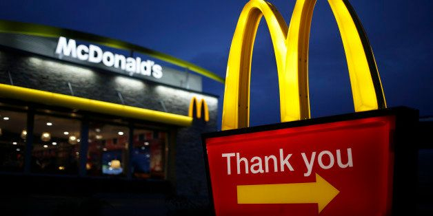 Golden arches mark the entrance to a McDonald's Corp. restaurant in Shelbyville, Kentucky, U.S., at dawn on Friday, Jan. 23,