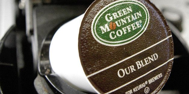 A Green Mountain Coffee single-serving brewing cup is seen in a Keurig machine in Montpelier, Vt., Thursday, Oct. 7, 2010. (A