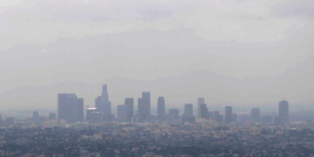 In this April 28, 2009 file photo, smog covers downtown Los Angeles. A new study in the journal Nature finds that while U.S.