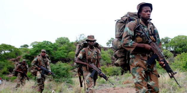 South African anti-poaching task team patrol in Kruger National Park on November 26, 2013. South African conservation authori
