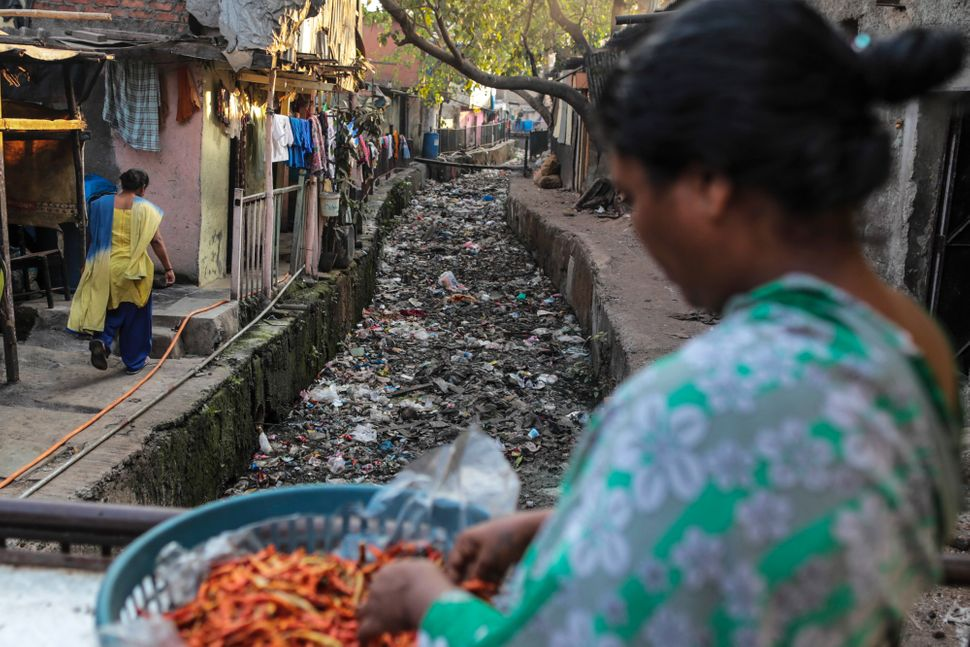 A gutter sits filled with garbage in the Govandi area of Mumbai, India, on Wednesday, March 11, 2015.