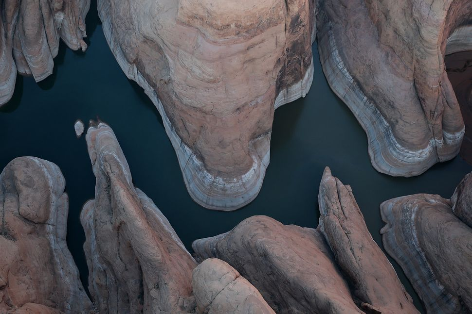 "A bleached ""bathtub ring"" is visible on the rocky banks of Lake Powell on March 28, 2015 in Lake Powell, Utah. As severe drou"