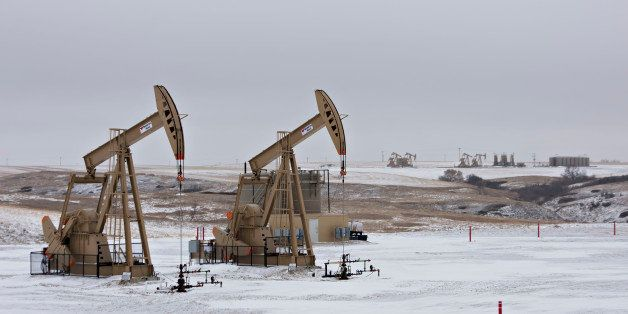 Pumpjacks operate at an oil well in Williston, North Dakota, U.S., on Sunday, Feb. 15, 2015. A plunge in global energy prices
