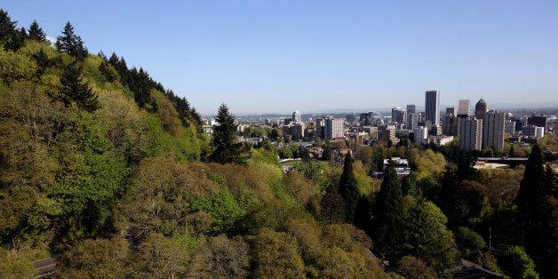 In this Wednesday, April 24, 2013 photo, the forested hills west of downtown Portland, Ore., shown here are honeycombed with