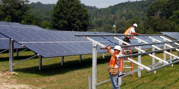 Crews complete construction of the solar panel structure at the O2 Energies solar panel farm in Newland, N.C., Thursday, Aug.