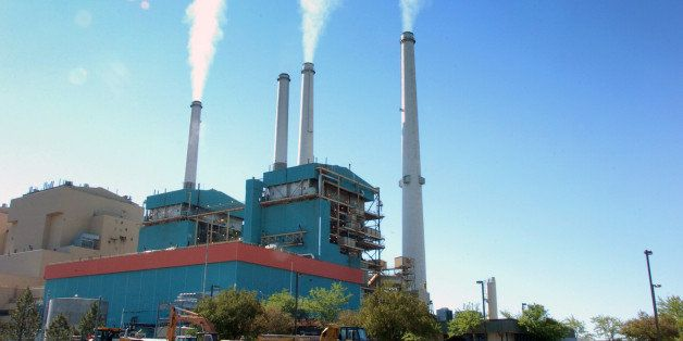 FILE - In this July 1, 2013, file photo,  smoke rises from the Colstrip Steam Electric Station, a coal burning power plant in