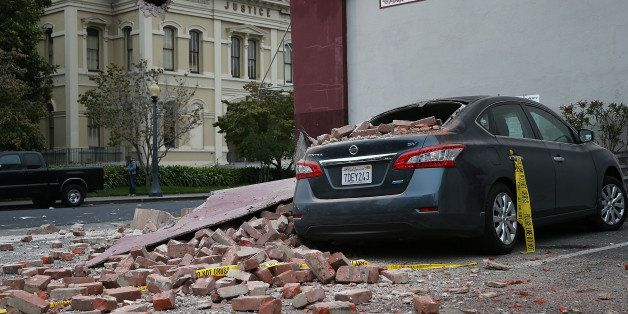 NAPA, CA - AUGUST 24:  Bricks from a damaged building sit on a car following a reported 6.0 earthquake on August 24, 2014 in